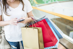 Women holding shopping bags Stock Photography