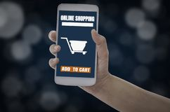 Women holding smartphone in hands with add to cart product to purchase online on blue bokeh background, With  shopping online royalty free stock photos
