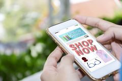 Women are holding a smartphone. Website online shopping concept stock images