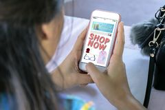 Women are holding a smartphone. Website online shopping concept royalty free stock photos