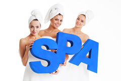 Women holding spa letters Royalty Free Stock Photo