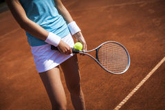 Women holding tennis racket on court Stock Photo