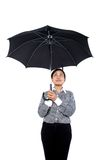 Women holding umbrella Stock Image