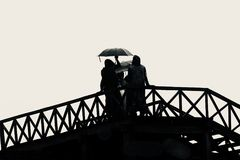 Women holding an umbrella in hand standing on a wooden stairs unique photo royalty free stock photos