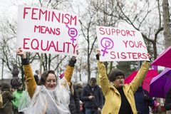 Women holding up equality signs on Womens March. Women holding up signs supporting gender equality on the Women's March on the International Women's Day in royalty free stock image