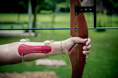 Women  holds her bow aiming Royalty Free Stock Images