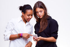 Women holds mobile phones Stock Image