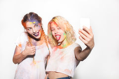 Women in Holi colors taking selfie royalty free stock image