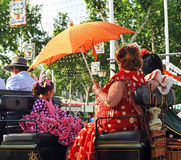 Women in a horse carriage, Seville Fair, Andalusia, Spain Royalty Free Stock Image