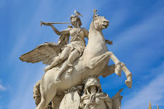 Women on horse Statue - Paris. Near Arch of triumph or Arc De Triomphe du carrousel in Paris - France Royalty Free Stock Images