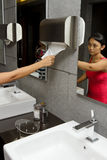 Women in hotel restroom Royalty Free Stock Photos
