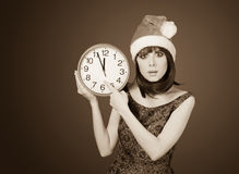 Women with huge clock Royalty Free Stock Images