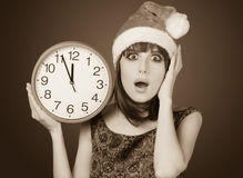 Women with huge clock Stock Images