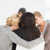 Women hugging in rehab group Stock Photography
