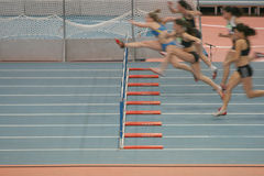 Women hurdlers race Royalty Free Stock Image