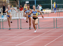 Women at the hurdles race Royalty Free Stock Images