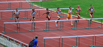 Women at the hurdles race Stock Photo