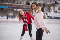Women ice skating outdoor at ice rink stock photography