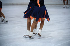 Women ice skating Stock Images