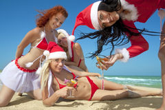 Women In Christmas Suit With Martini On The Beach Royalty Free Stock Photos
