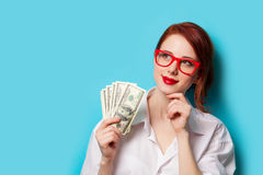 Women In Red Glasses With Money Stock Photo