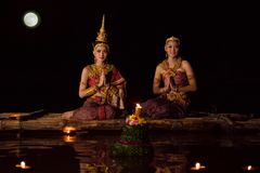 Women In Traditional Thai Dress Floating Krathong Royalty Free Stock Photos