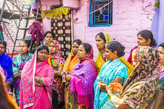 Women in India listening to a street teacher in the poor area of Stock Photo