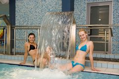 Women at indoor pool stock photos