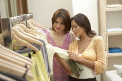 Women Inspecting Clothes Stock Photography