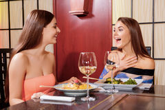 Women interact in a restaurant Royalty Free Stock Images