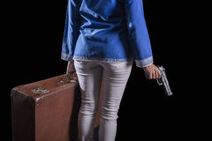 Women with Islamic headscarf subject suitcase and gun Stock Photography