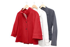 Women jackets. Three women jackets on shoulders in store Royalty Free Stock Photography