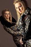 Women in jackets with snakeskin texture Royalty Free Stock Photos