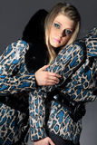 Women in jackets with snakeskin texture. Two young woman in jackets with snakeskin texture Stock Photography