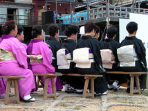 Women Japanese audience. A specific audience at a outdoor Japanese show Royalty Free Stock Photo
