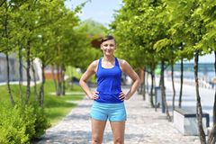 Women jogger in park smiling. Royalty Free Stock Images