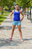 Women jogger in park smiling. Royalty Free Stock Photos