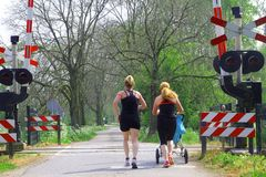 Women are jogging with baby in stroller, Tricht, Betuwe,Holland Royalty Free Stock Image