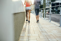 Women jogging in city in dusk Stock Image