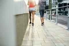 Women jogging in city in dusk Stock Image