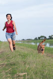 Women jogging with dog Stock Images