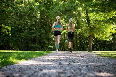 Women Jogging On Gravel Road Royalty Free Stock Photos
