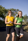 Women jogging and laughingf. Two women jogging and having fun doing it Stock Images