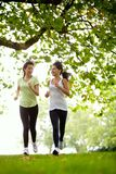 Women jogging outdoors Stock Images