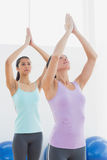 Women with joined hands in fitness studio Stock Photography