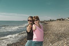 Women joking in a portrait on the beach, vacation time, summer royalty free stock image