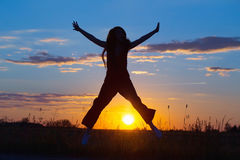 Women joyfully jumping at sunset Royalty Free Stock Photo