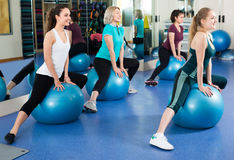 Women jumping on exercise ball Royalty Free Stock Photo