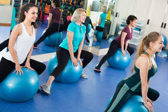 Women jumping on exercise ball Stock Images