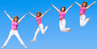 Women jumping in a group Stock Images